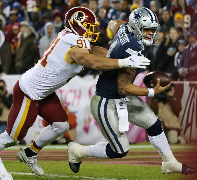 Dallas Cowboys quarterback Dak Prescott fumbles the ball while being sacked by Washington Redskins linebacker Ryan Kerrigan in the fourth quarter at FedEx Field.