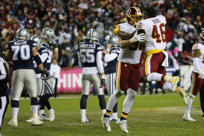 Washington Redskins running back Kapri Bibbs (46) celebrates with Redskins linebacker Ryan Kerrigan (91) after Dallas Cowboys kicker Brett Maher (2) misses a game-tying field goal attempt on the final play of the fourth quarter at FedEx Field.