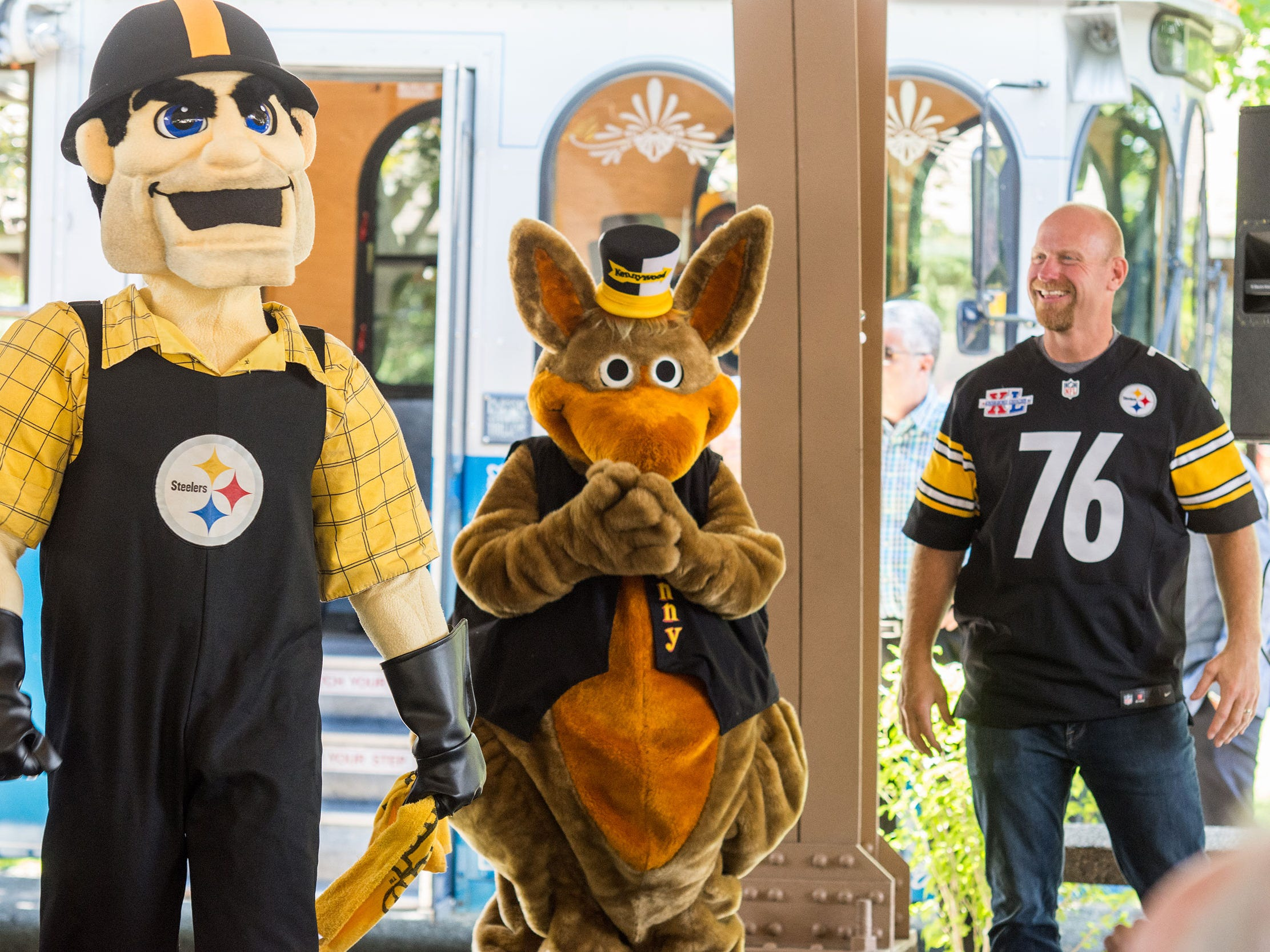 Steelers mascot Steely McBeam, Kennywood mascot Kenny Kangaroo and former Steeler Chris Hoke appear at the press conference to announce Steelers Country.