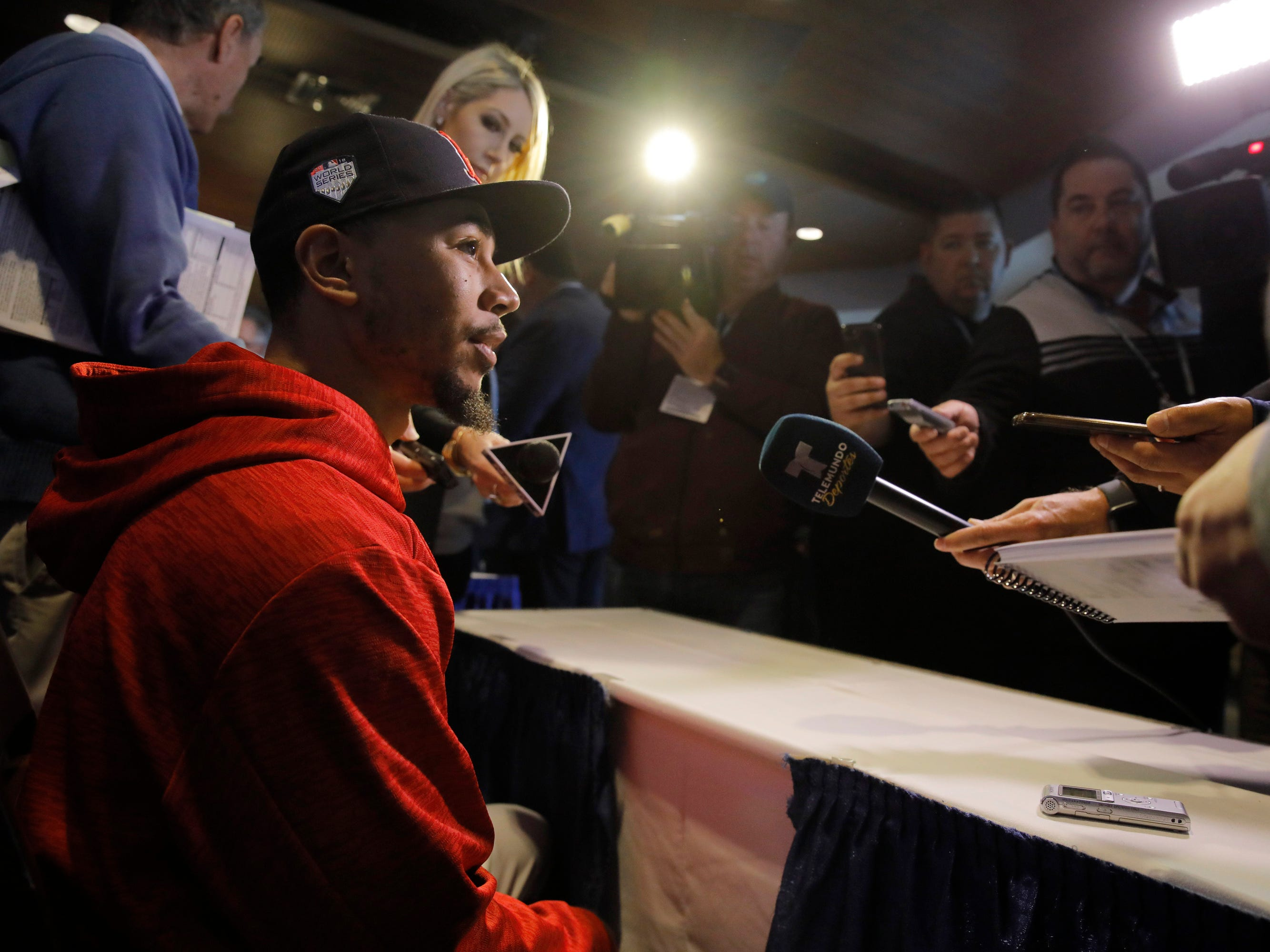 Red Sox right fielder Mookie Betts meets the press.