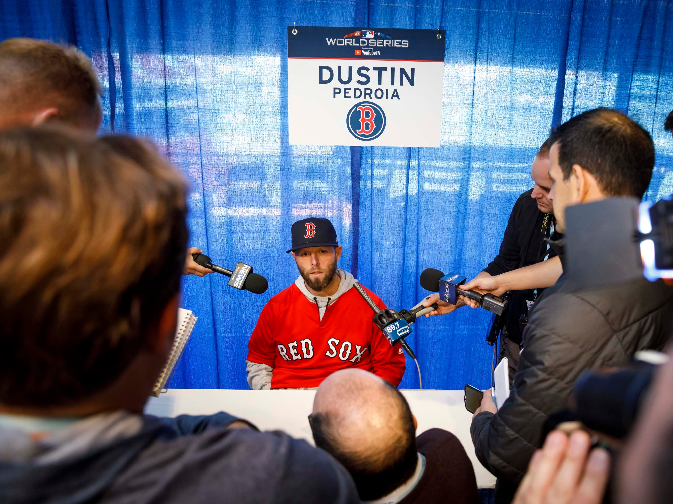 Red Sox second baseman Dustin Pedroia talks to reporters.