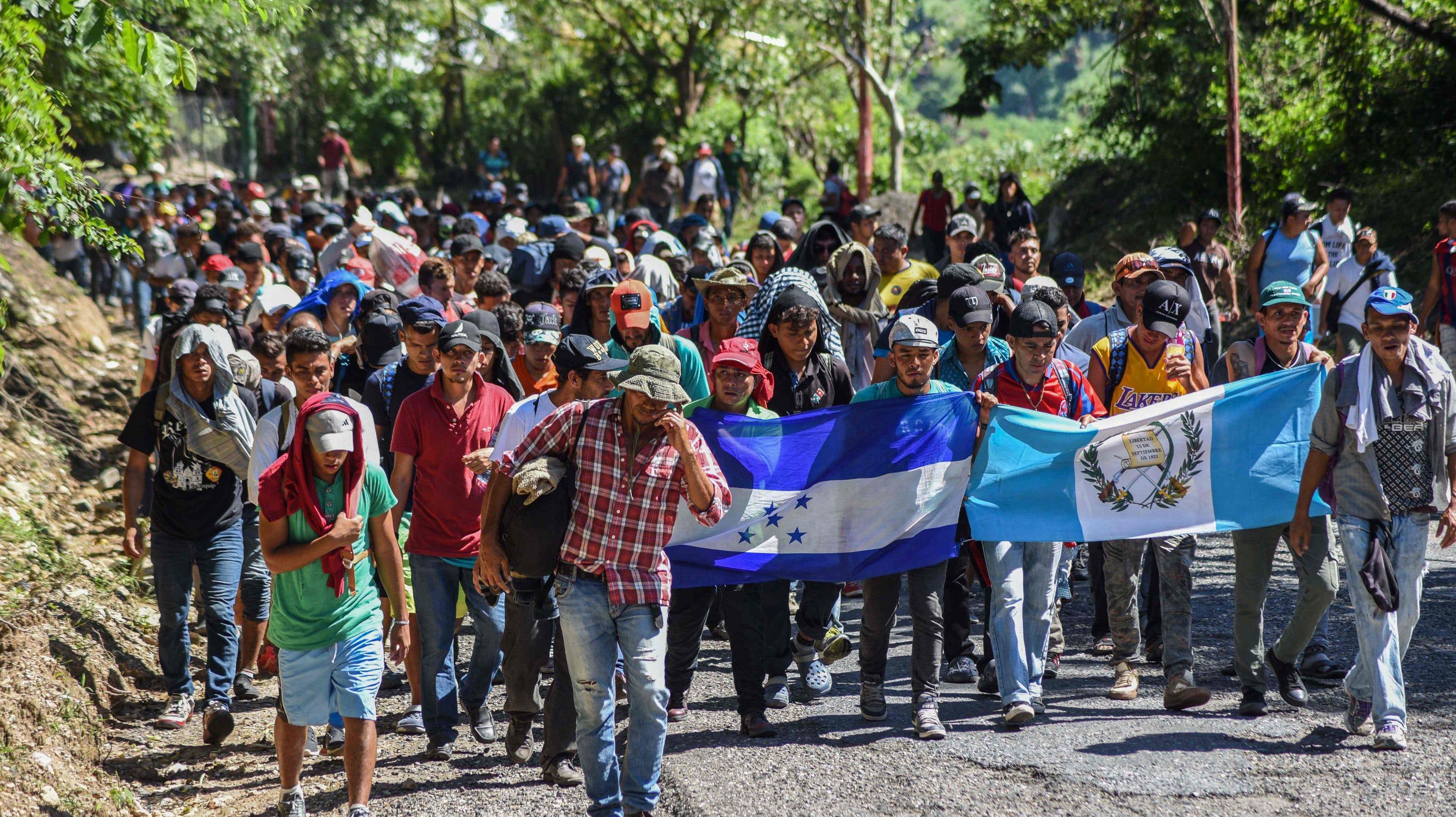 Image result for migrant caravan, waving flags, photos
