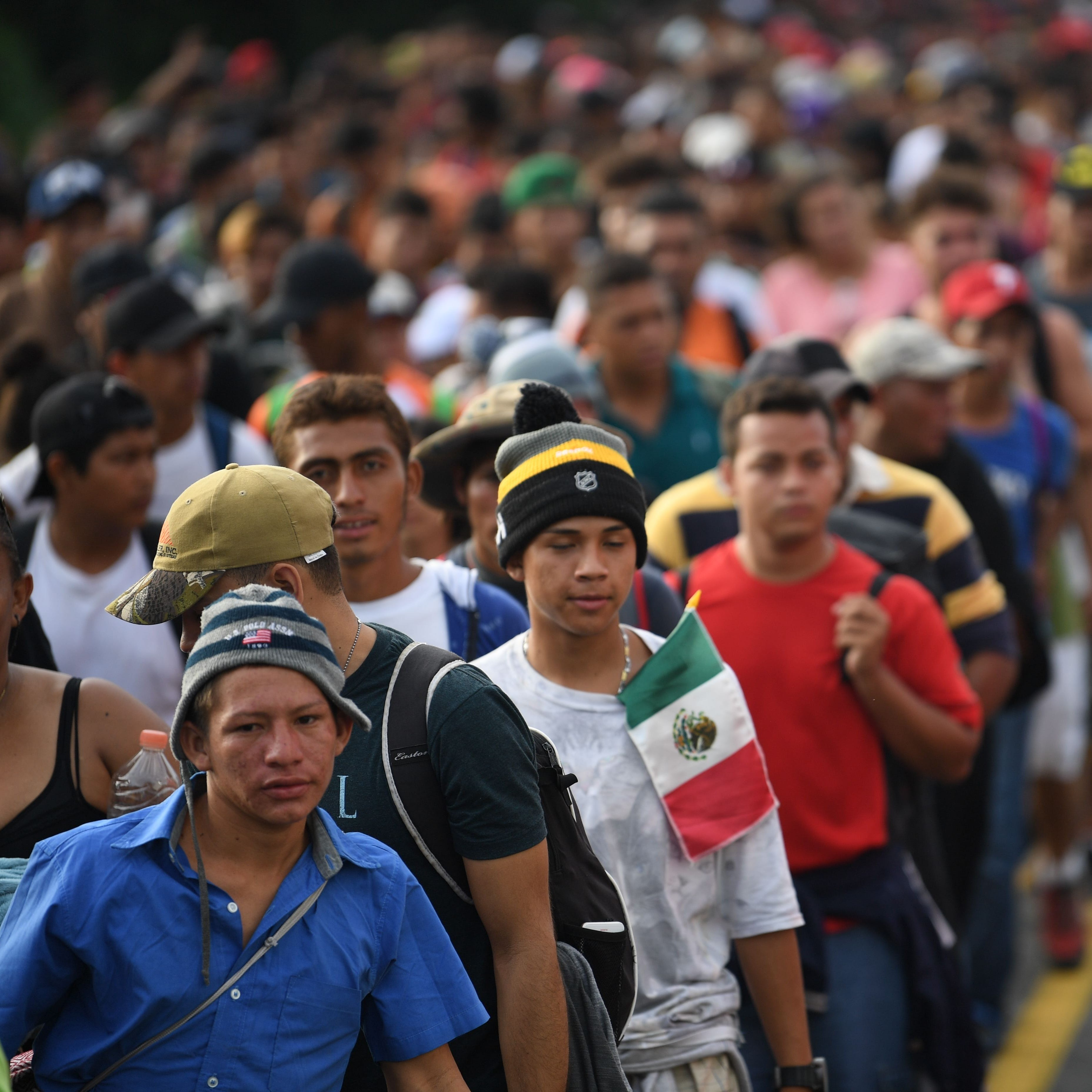 Honduran migrants take part in a caravan heading...