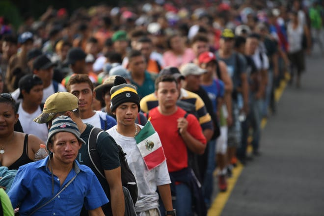 Honduran migrants take part in a caravan heading to the US on the road linking Ciudad Hidalgo and Tapachula, Chiapas state, Mexico on October 21, 2018. - Thousands of Honduran migrants resumed their march toward the United States on Sunday from the southern Mexican city of Ciudad Hidalgo, AFP journalists at the scene said.
