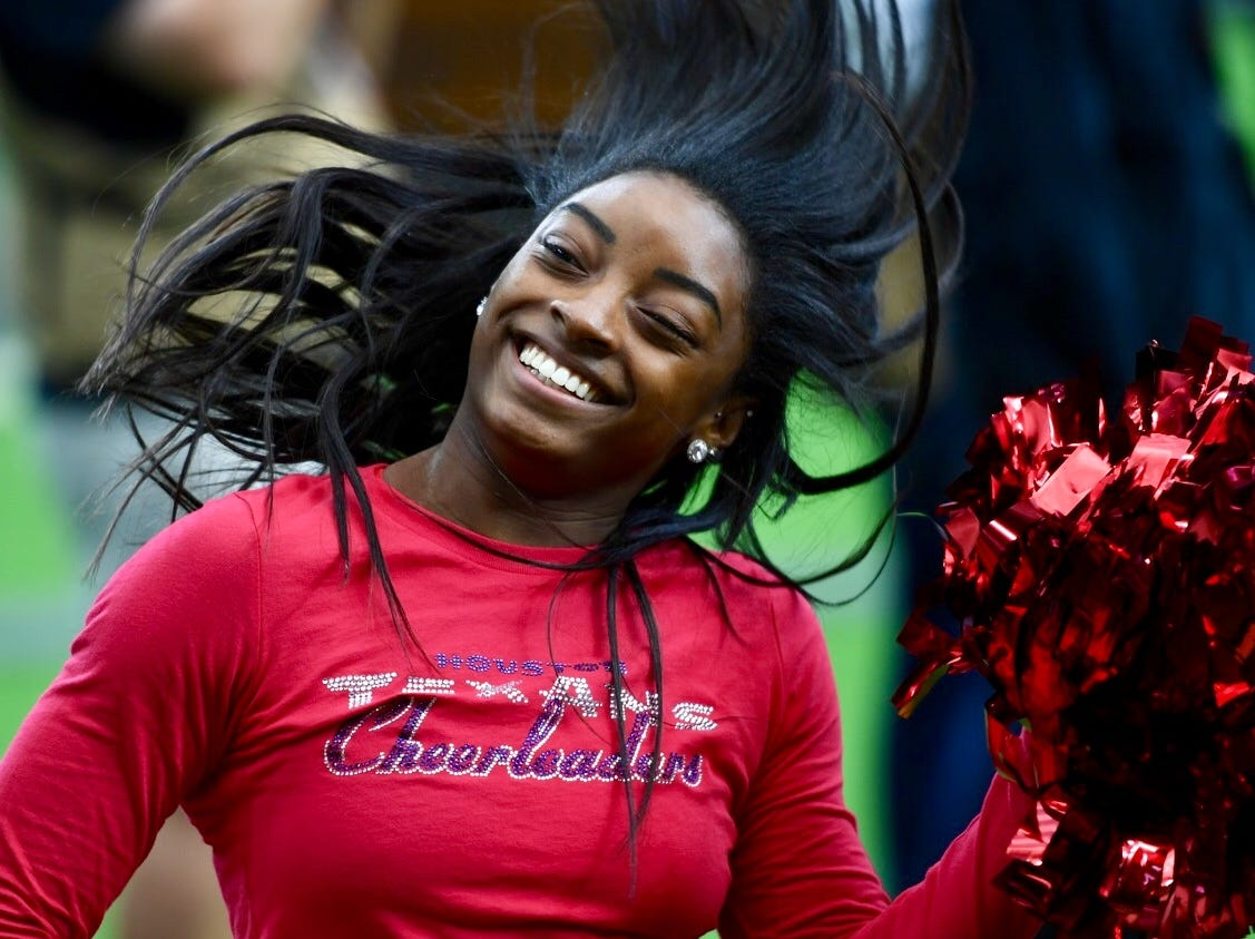 In 2017, Simone Biles takes in an NFL game between her hometown Houston Texans and the San Francisco 49ers at NRG Stadium.