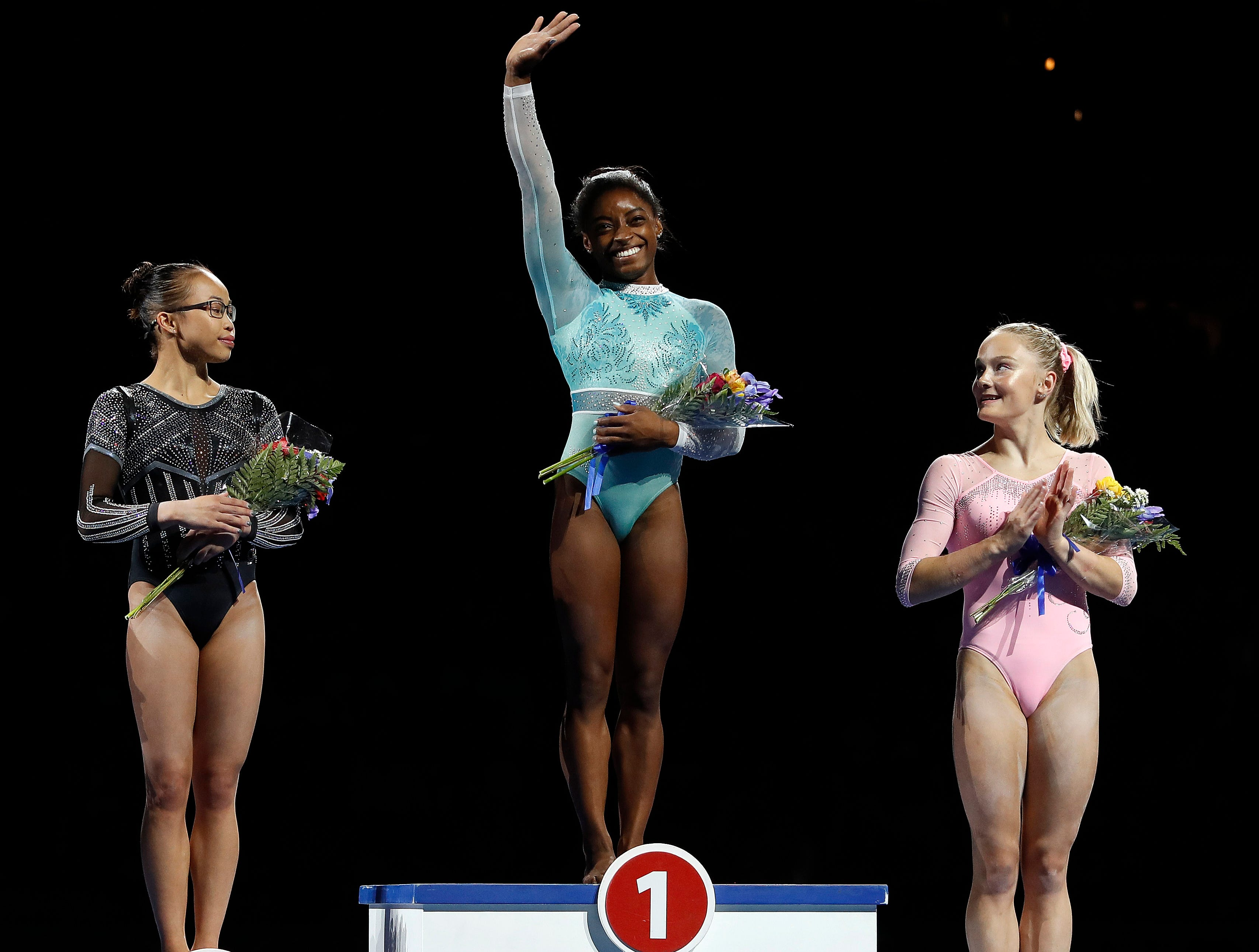 After a year away from the sport, Simone Biles comes back to win the  women's all-around during the 2018 U.S. Gymnastics Championships at TD Garden. Here's Biles is with Morgan Hurd and Riley MCusker.