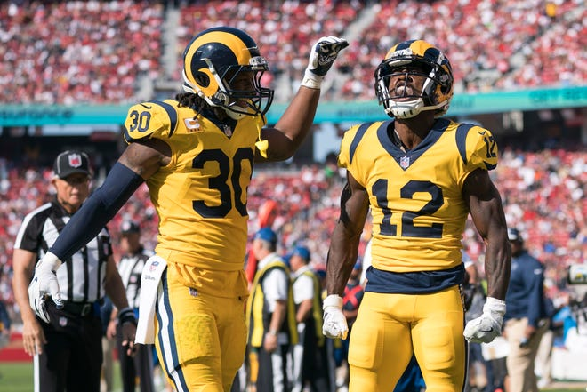 Los Angeles Rams wide receiver Brandin Cooks (12) celebrates after scoring a touchdown in front of running back Todd Gurley (30) against the San Francisco 49ers during the second quarter at Levi's Stadium.