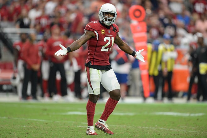 Arizona Cardinals defensive back Patrick Peterson (21) reacts against the Chicago Bears after a play at State Farm Stadium.
