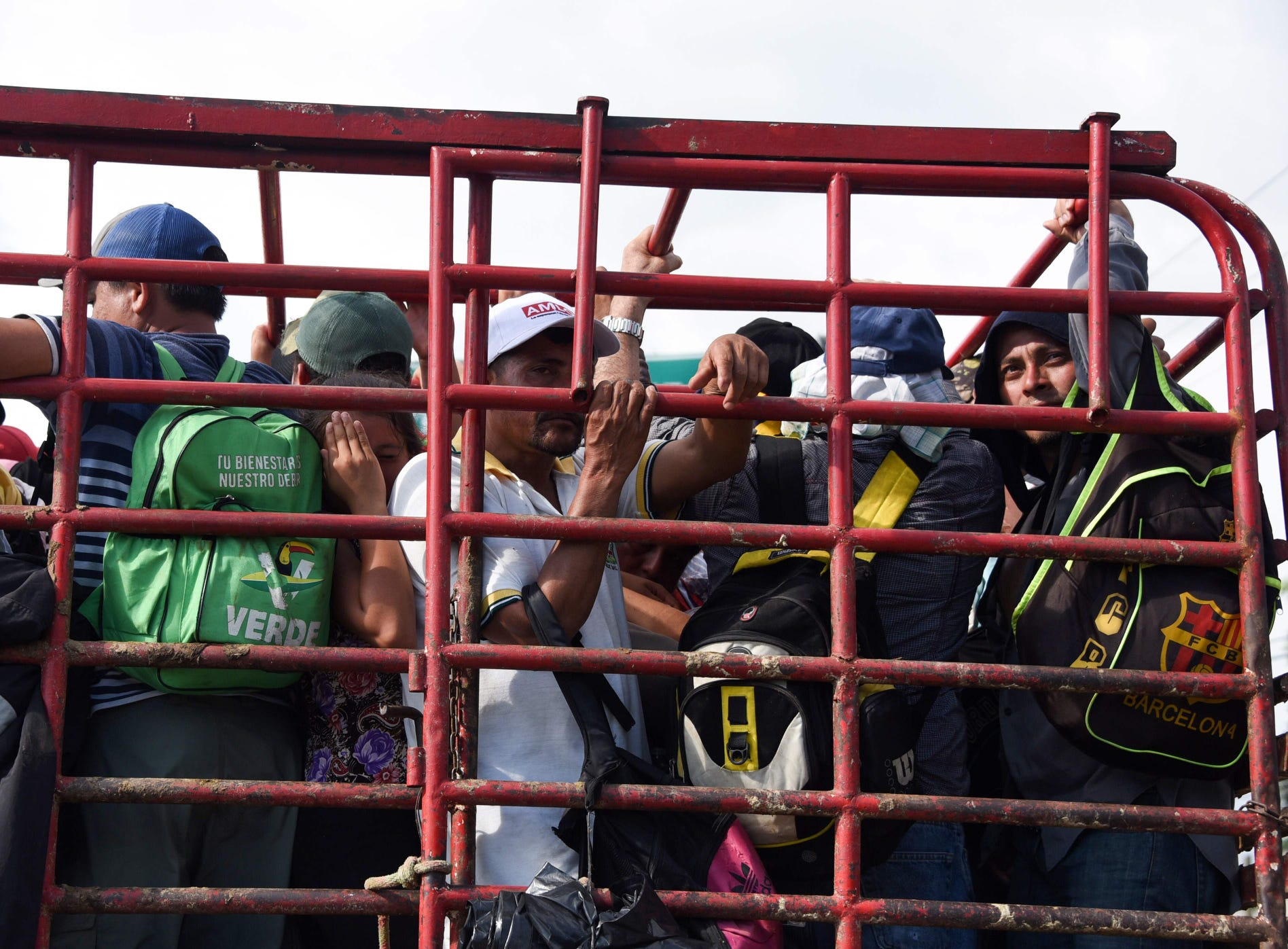 Migrants onboard a truck take part in a caravan heading to the US, near Huehuetan, on their way from Tapachula to Huixtla, Chiapas state, Mexico.