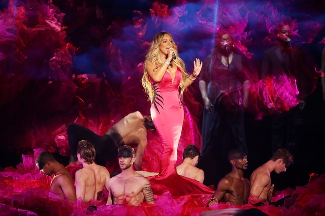 "Mariah Carey performs ""With You"" onstage during the 2018 American Music Awards on October 9, 2018. The song is from her upcoming 15th studio album, ""Caution."""