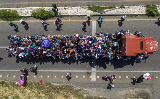 Aerial view of Honduran migrants onboard a truck as they take part in a caravan heading to the US, in the outskirts of Tapachula, on their way to Huixtla, Chiapas state, Mexico, on October 22, 2018.