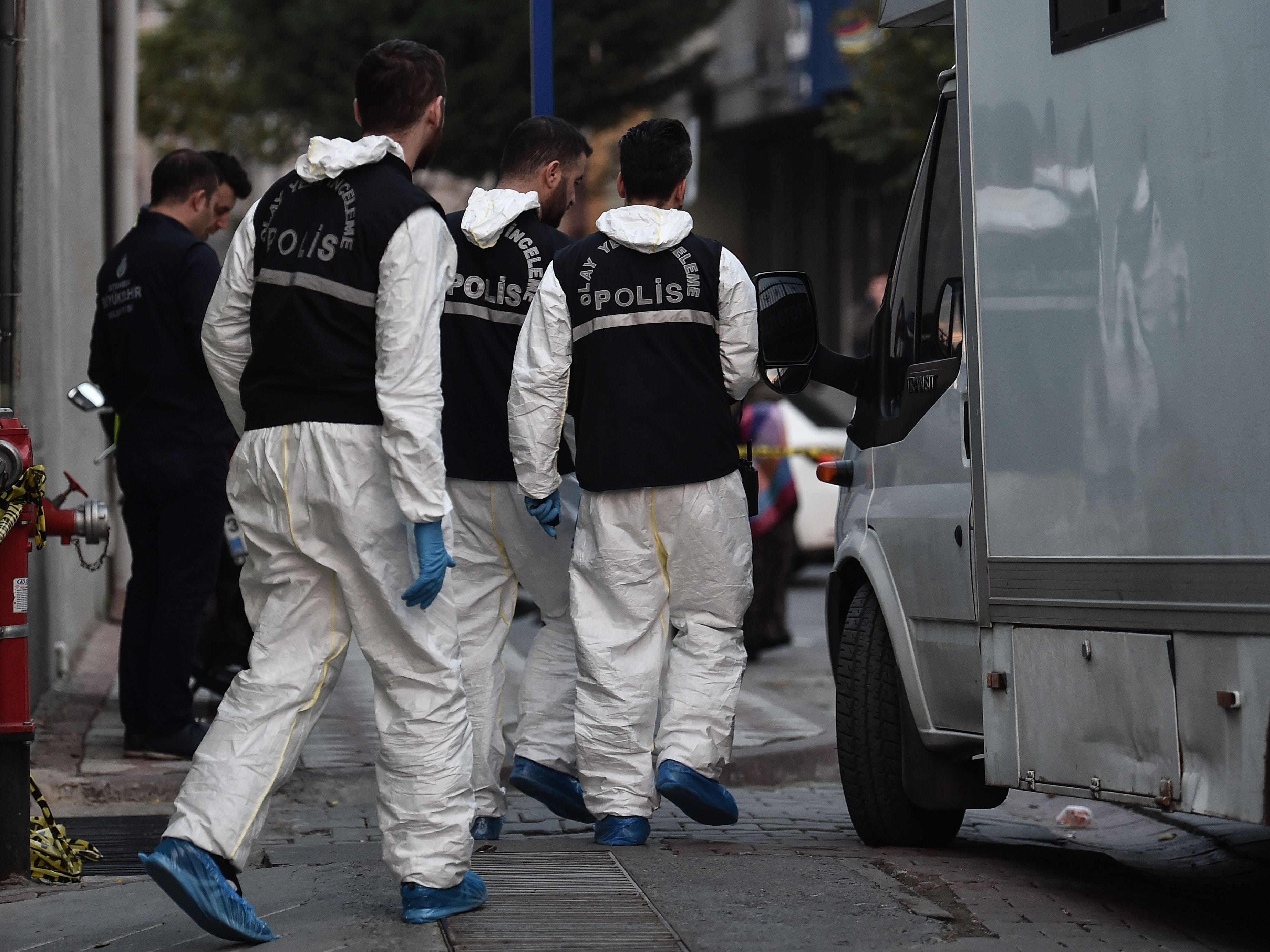 Turkish forensics leave an underground car park cordoned off by Turkish police, Oct. 22, 2018, in Istanbul, after police found an abandoned car belonging to the Saudi consulate, three weeks after the murder of journalist Jamal Khashoggi in the Saudi consulate.