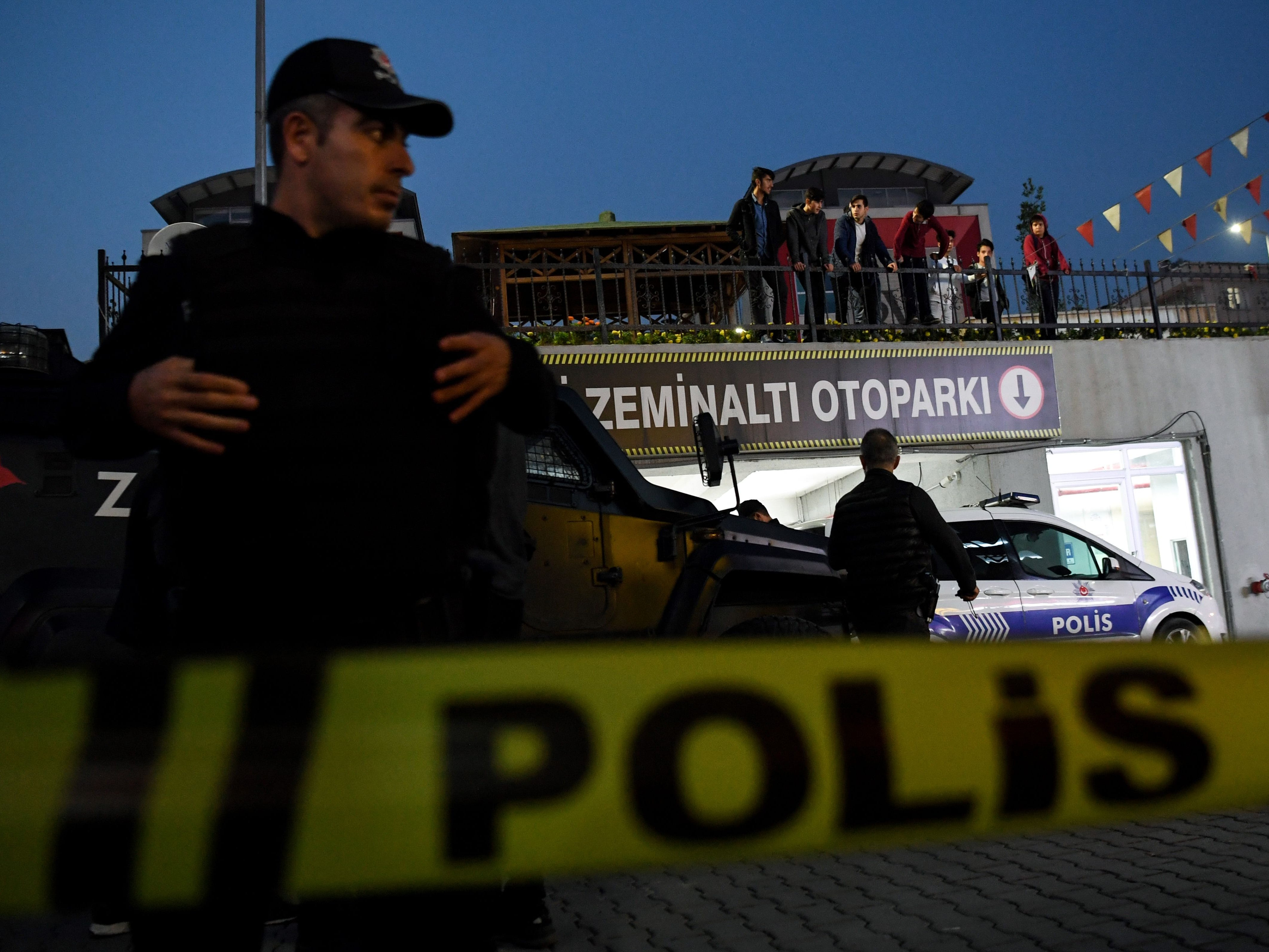 Turkish police stand guard as they cordoned off an underground car park, Oct. 22, 2018, in Istanbul, after they found an abandoned car belonging to the Saudi consulate, three weeks after the murder of journalist Jamal Khashoggi in the Saudi consulate.
