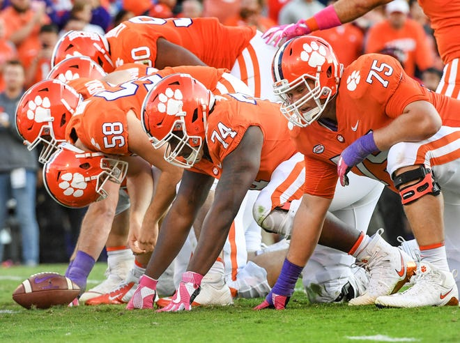Clemson offensive lineman Mitch Hyatt (75) sets up with teammates offensive guard John Simpson (74) and long snapper Patrick Phibbs (58) during the third quarter in Memorial Stadium on Saturday, October 20, 2018.