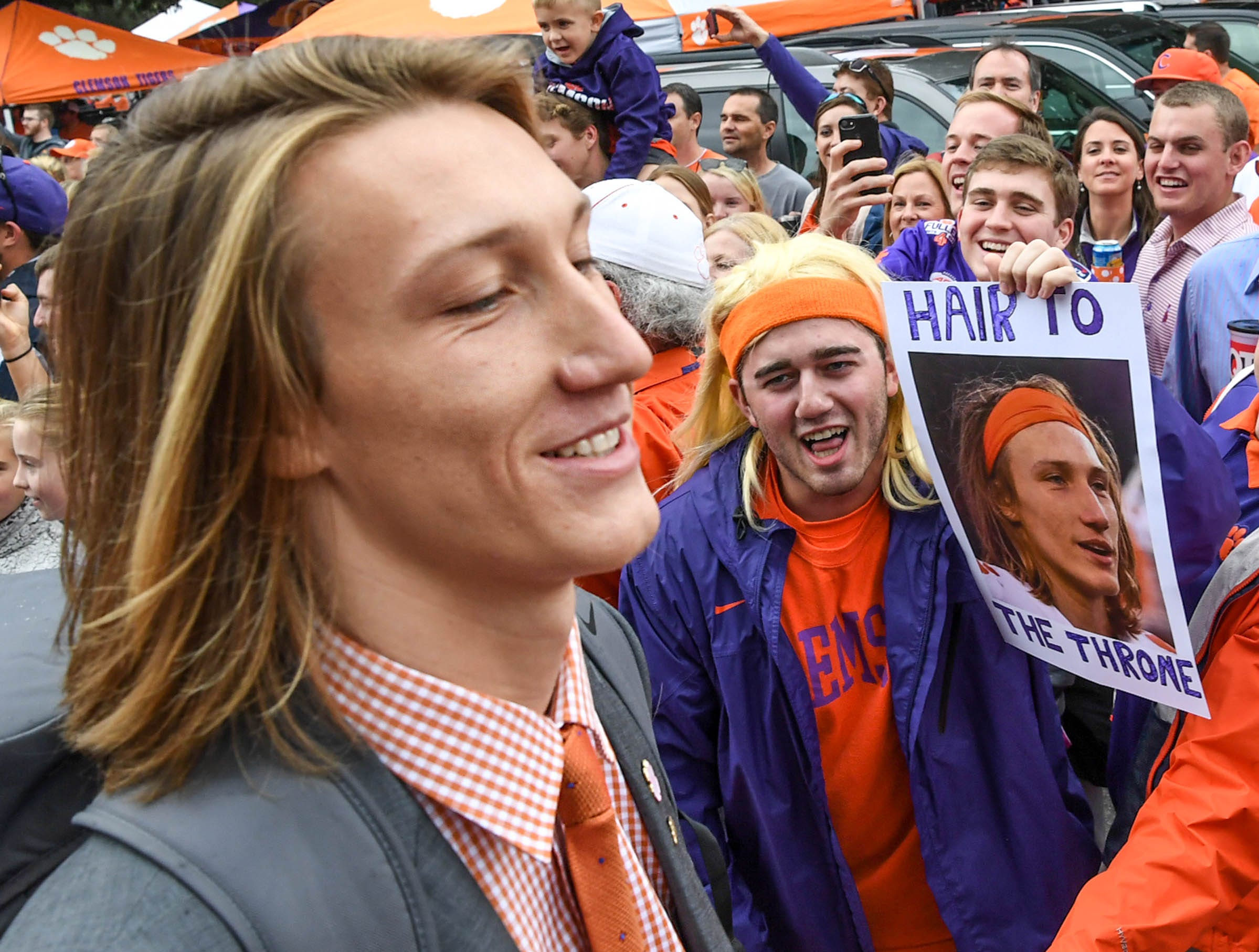 Clemson quarterback Trevor Lawrence (16) passes a fan of his during the first quarter in Memorial Stadium on Saturday, October 20, 2018.