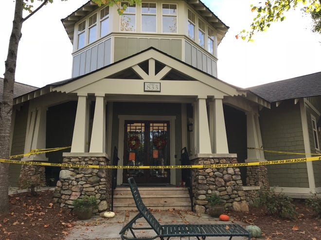 A black sheet was placed behind the glass at the Woodlands clubhouse on Monday, blocking the view into the area where the floor collapsed on Sunday.