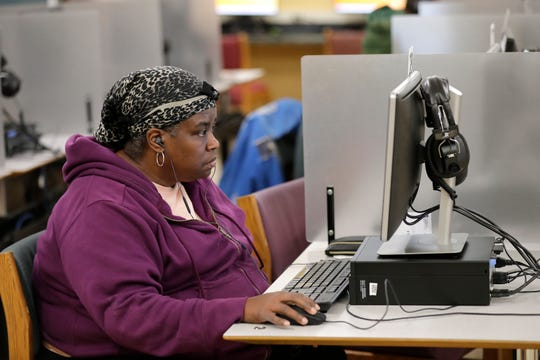 Antoinette Sullivan of Appleton uses a computer Monday at the Appleton Public Library to search for an apartment to rent.