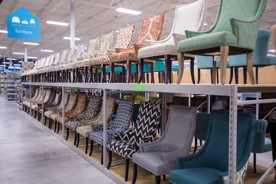 An aisle of chair in an At Home store.