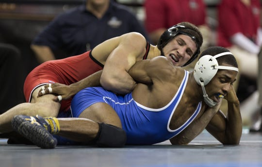 Anthony Ashnault (top) is one of two national contenders the Rutgers University wrestling program has.