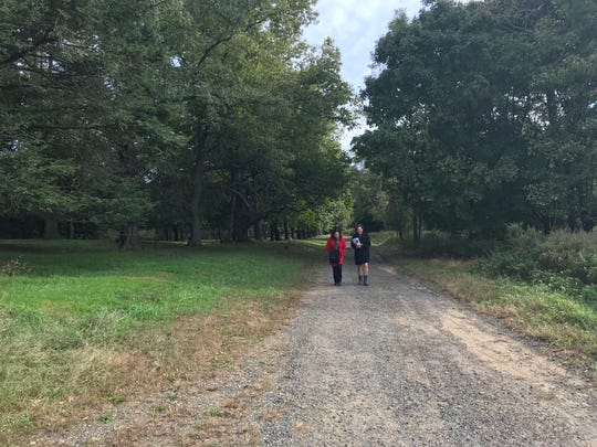 Marianne Kligman, left, and Diane Fisler walk along a road at Stevenson Park. The two are leaders in a grassroots group of neighbors who are opposing the creation of soccer fields at the park.