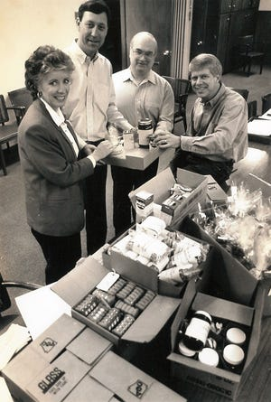 Products from the Abilene area are packed for a trip to Austin in 1995 for Texas Midwest Day in the state Legislature. From left, are Nicki Harle of Baird, Rick Rhodes of Sweetwater, James Campbell of Brownwood and Charlie Dromgoole of Abilene.