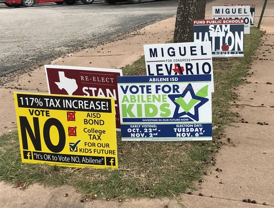 A sure sign that early voting has started is the number of signs near entrances to early voting locations, such as these by the parking lot for the Taylor County Plaza.