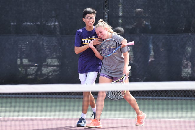 Wylie's Anthony Zhang, left, and Mandy Roberson celebrate after winning in three sets at the Region I-5A quarterfinal at Vernon on Tuesday. Zhang and Roberson came back after losing the first set.