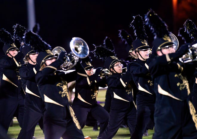 Members of the Abilene High School Eagle Band perform Monday. The University Interscholastic League regional marching band contest was held at Wylie High School.