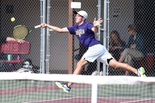 Wylie's Lane Adkins reaches for a shot during No. 1 boys doubles at the Region I-5A quarterfinal at Vernon on Tuesday. Adkins and partner Davyn Williford won 6-4, 6-3.