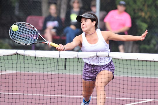 Wylie's Analeah Elias hits a shot at the net during the No. 1 girls doubles match at the Region I-5A quarterfinal at Vernon on Tuesday. Elias and partner Leighton Alford won 7-5, 6-3.