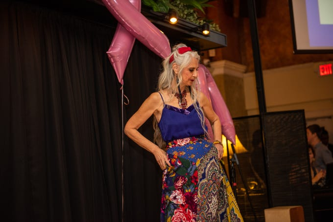 Breast cancer survivor Laura Miklowitz, of Hendersonville, models an outfit from Anthropologie at the Here's Hope Fashion Show and Luncheon to benefit the Hope Chest for Women on Oct. 20.