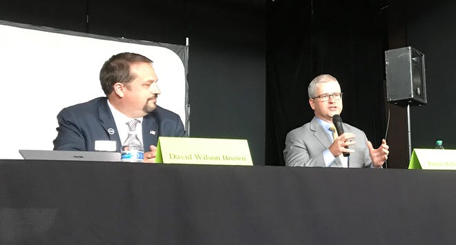 Democrat David Wilson Brown, left, listens while Republican U.S. Rep. Patrick McHenry speaks during a debate for 10th District candidates in Asheville Tuesday.