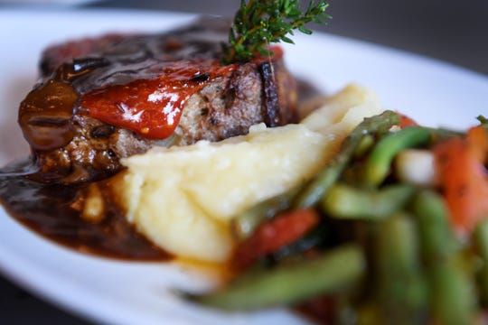 The Continental Lounge's Teague Natural Farms meatloaf with local Wagyu/Angus beef from Fletcher, mushroom gravy, wonder taters and snap bean ragout.