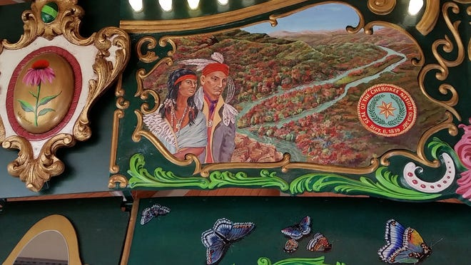 This rounding board painting is part of a work of public art, the Kingsport carousel, built, carved, and painted by regional artists. It includes the Cherokee at Long Island in its pageant. (Photo by Rob Neufeld)