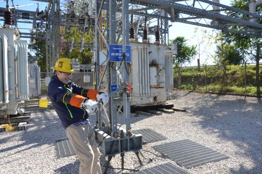 Bradley Sparks, a senior at Jackson Northwest High School, interacts with the de-energized substation at the Consumers Energy Marshall Training Center on Oct. 16, 2018.