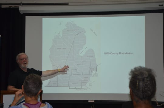 Jim Jackson of Battle Creek points to a map showing the 1830 county boundaries in Michigan during a genealogy workshop on October 16, 2018.