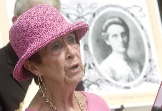 """In 2009, Patricia Donohue of Binghamton reads a poem titled """"Mother Connor"""", a story of Nellie Connor's heroism during the Binghamton Clothing Company fire of 913, during a dedication of a memorial for the fire's victims on the 96th anniversary of the event on Wall Street in Binghamton. Donahue is a great niece of Connor."""