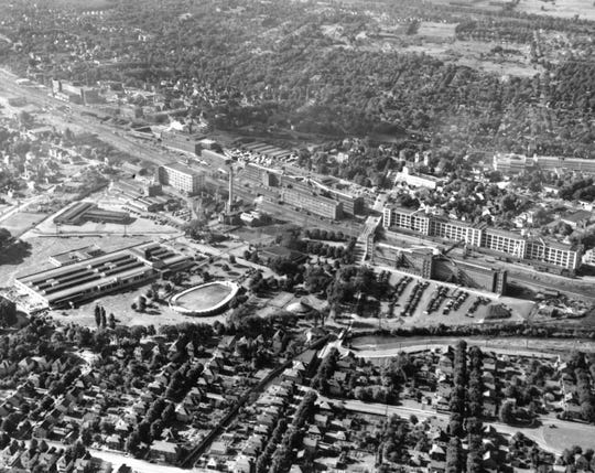 A Bob Garvin aerial photograph of the Endicott Johnson factory complex around CFJ Park in Johnson City, about 1960.