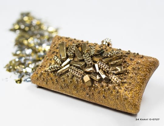 24 Karat clutch, Mercedes Brunelli