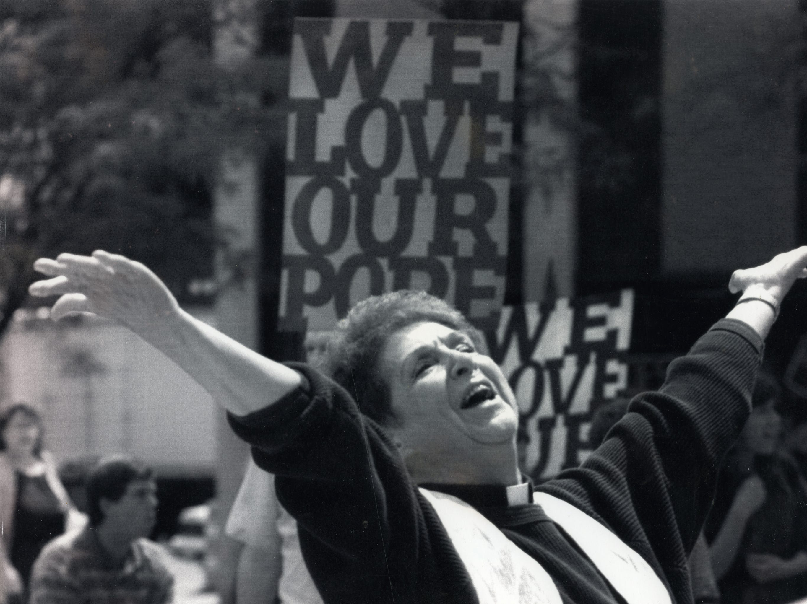 Patricia Donohue of Binghamton, shown in 1994 in front of the Cathedral of Immaculate Conception in Syracuse in 1994, doing a one-woman show called Solo Flight. She was there with a group of women called Sarah's Circle who sought equality within the Catholic Church. Many people protested while Donohue performed.