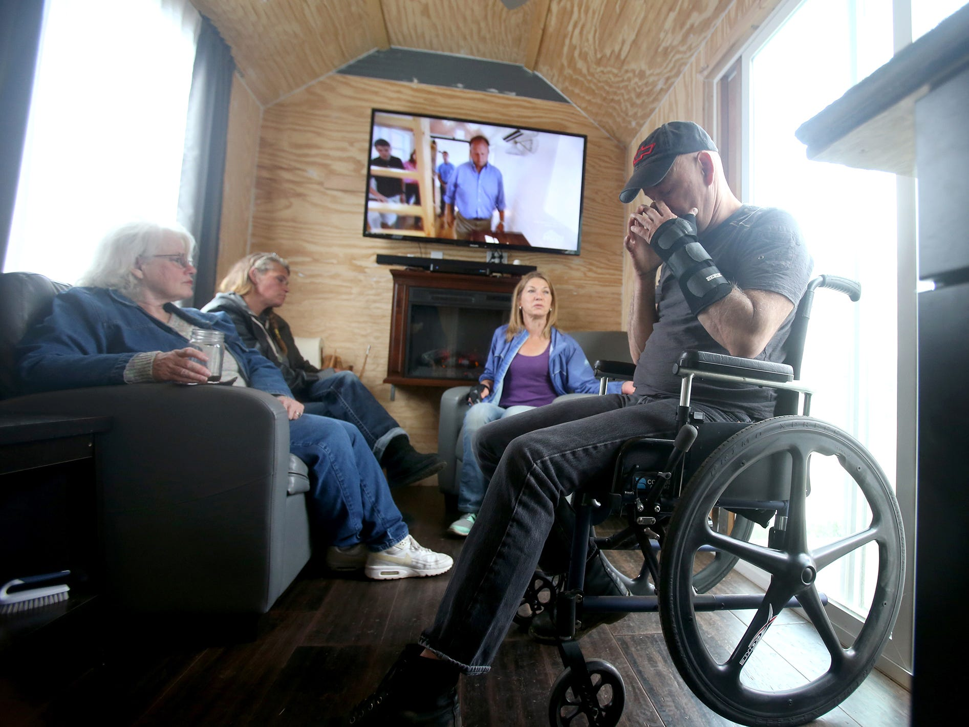 Sam Rye a disabled veteran inside of his unfinished  tiny home in the Seabeck area on Tuesday, October 23, 2018. He previous was homeless and leaving in a tent at Manchester State Park. Volunteers rallied to build a tiny home for a disabled veteran and homeowner offered to let him park it on their property. But after seven months, an inspector told the property owner the tiny house violated zoning.