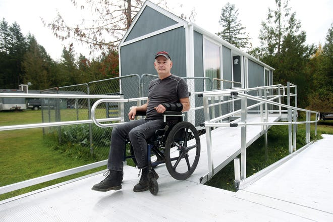 Sam Rye had been homeless before friends built a tiny home for him on a trailer chassis. The wheeled home is now parked at a relative's property in Seabeck, but its placement there violates Kitsap County code.