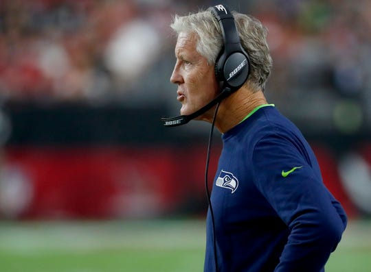 Seahawks coach Pete Carroll says he's to blame for the team failing to stick with its running game in losses to Denver and Chicago at the beginning of the season.