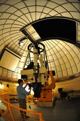 Daniel Batcheldor, who heads Florida Tech's aerospace, physics and space sciences departments, works on the 32-inch Ortega telescope at the F.W. Olin Physical Sciences Center.