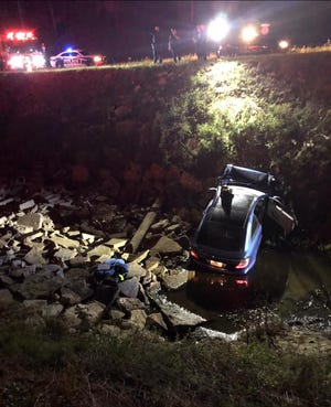 Crash into canal injures one in Palm Bay
