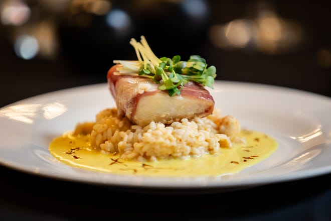 Sea bass wrapped in prosciutto with lemon lobster risotto and vanilla saffron beurre blanc is one of the seven courses at Café Margaux's Single Vineyards dinner Nov. 1 and 2.