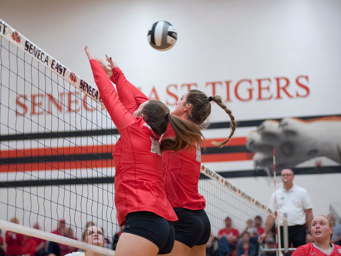 Buckeye Central's Ally Sostakowski and Lexi Evak attempt to block a ball at the net.