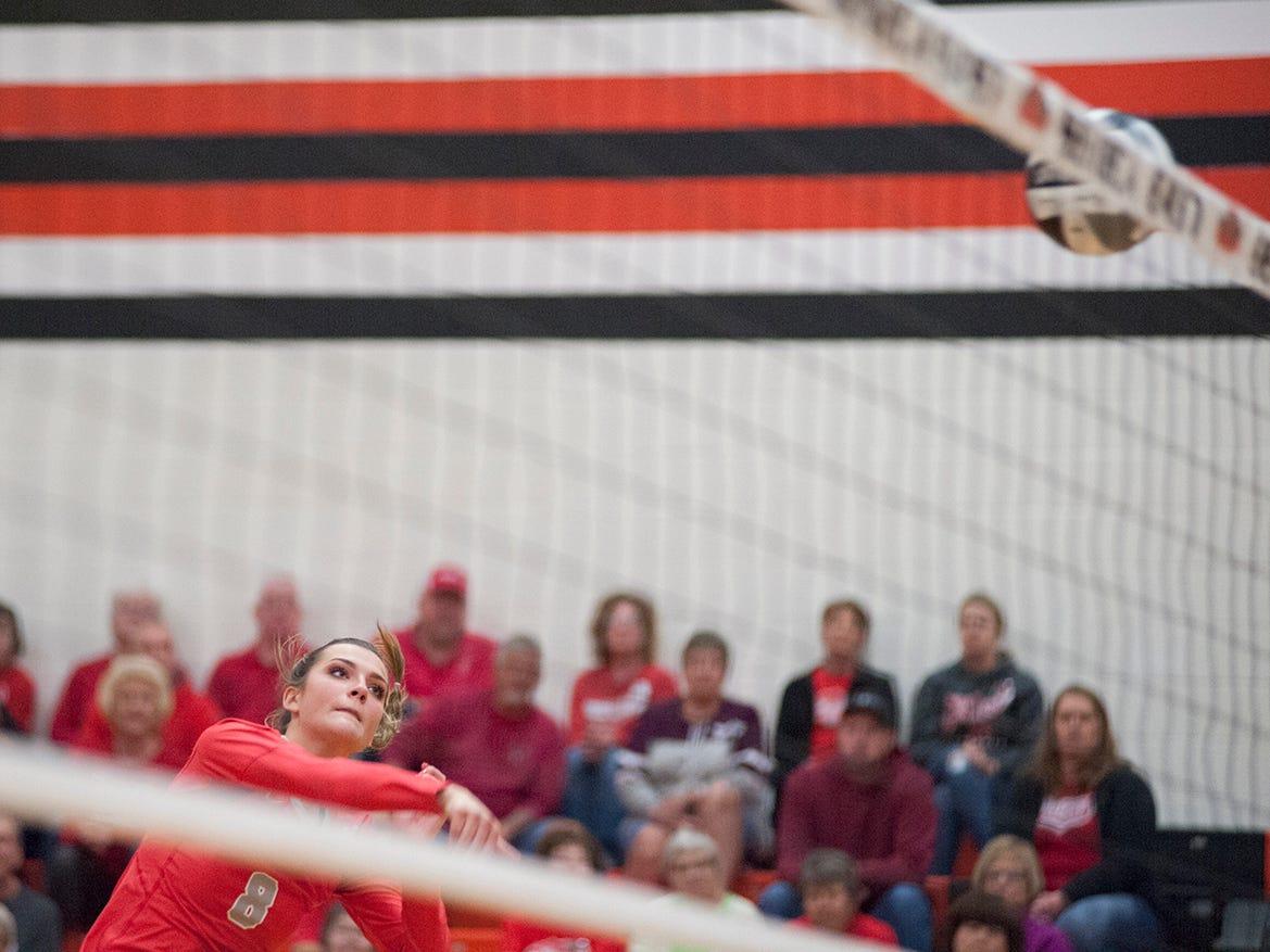 Buckeye Central's Lexi Evak hits a ball across the net.