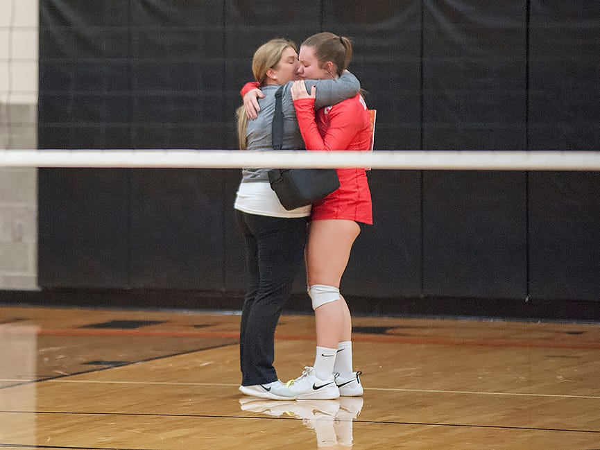 Buckeye Central's Ally Sostakowski is comforted following the loss to Monroeville.