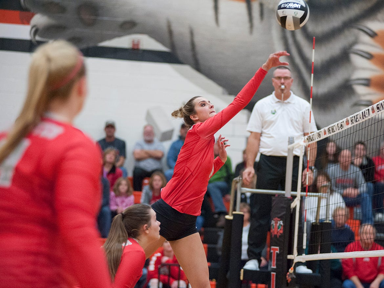 Buckeye Central's Lexi Evak pushes a ball over the net.